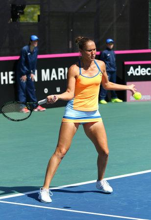forehand: KYIV, UKRAINE - APRIL 17, 2016: Kateryna Bondarenko of Ukraine in action during BNP Paribas FedCup World Group II Play-off pair game against Argentina at Campa Bucha Tennis Club in Kyiv, Ukraine Editorial