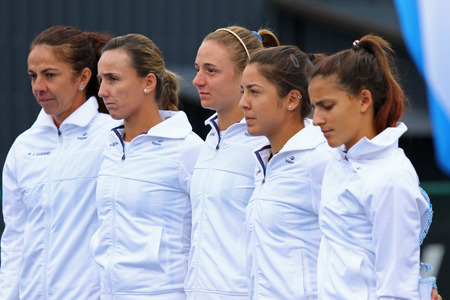 anthem: KYIV, UKRAINE - APRIL 16, 2016: Argentina National Team listen national anthem before BNP Paribas FedCup World Group II Play-off game Ukraine vs Argentina at Campa Bucha Tennis Club in Kyiv, Ukraine