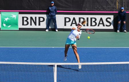 forehand: KYIV, UKRAINE - APRIL 17, 2016: Lesia Tsurenko of Ukraine in action during BNP Paribas FedCup World Group II Play-off game against Maria Irigoyen of Argentina at Campa Bucha Tennis Club in Kyiv