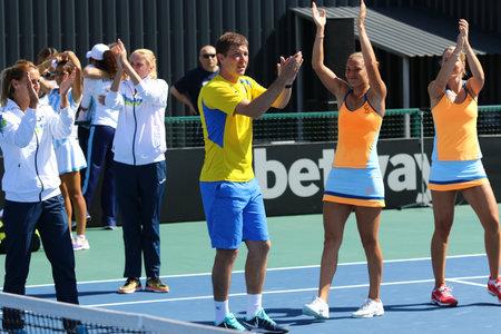 react: KYIV, UKRAINE - APRIL 17, 2016: Ukraine National Tennis Team react after BNP Paribas FedCup match against Argentina at Campa Bucha Tennis Club in Kyiv, Ukraine
