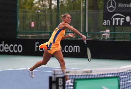 grand hard: KYIV, UKRAINE - APRIL 16, 2016: Kateryna Bondarenko of Ukraine in action during BNP Paribas FedCup World Group II Play-off game against Maria Irigoyen of Argentina at Campa Bucha Tennis Club in Kyiv