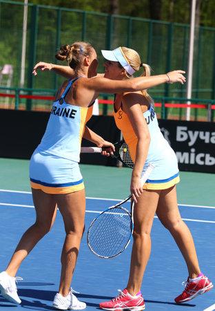 react: KYIV, UKRAINE - APRIL 17, 2016: Kateryna Bondarenko and Olga Savchuk of Ukraine react during BNP Paribas FedCup match against Maria Irigoyen of Argentina at Campa Bucha Tennis Club in Kyiv, Ukraine