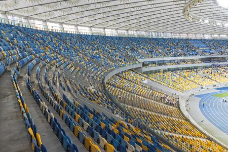 premier league: KYIV, UKRAINE - APRIL 10, 2016: Tribunes of NSC Olympic stadium (NSC Olimpiyskyi) during Ukraine Premier League game FC Dynamo Kyiv vs FC Volyn in Kyiv, Ukraine Editorial
