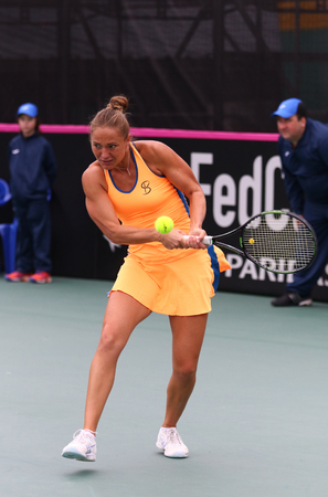 paribas: KYIV, UKRAINE - APRIL 16, 2016: Kateryna Bondarenko of Ukraine in action during BNP Paribas FedCup World Group II Play-off game against Maria Irigoyen of Argentina at Campa Bucha Tennis Club in Kyiv