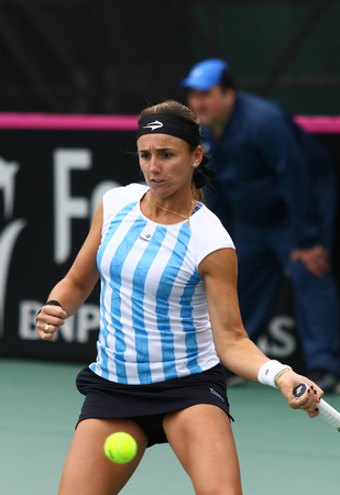 grand hard: KYIV, UKRAINE - APRIL 16, 2016: Maria Irigoyen of Argentina in action during BNP Paribas FedCup World Group II Play-off game against Kateryna Bondarenko of Ukraine at Campa Bucha Tennis Club in Kyiv