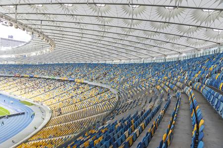 olimpiysky: KYIV, UKRAINE - APRIL 10, 2016: Tribunes of NSC Olympic stadium (NSC Olimpiyskyi) during Ukraine Premier League game FC Dynamo Kyiv vs FC Volyn in Kyiv, Ukraine Editorial