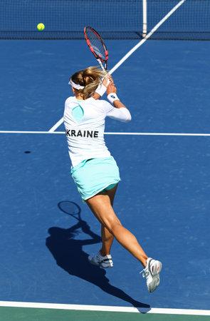 paribas: KYIV, UKRAINE - APRIL 17, 2016: Lesia Tsurenko of Ukraine in action during BNP Paribas FedCup World Group II Play-off game against Maria Irigoyen of Argentina at Campa Bucha Tennis Club in Kyiv