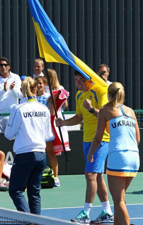 paribas: KYIV, UKRAINE - APRIL 17, 2016: Ukraine National Tennis Team react after BNP Paribas FedCup match against Argentina at Campa Bucha Tennis Club in Kyiv, Ukraine