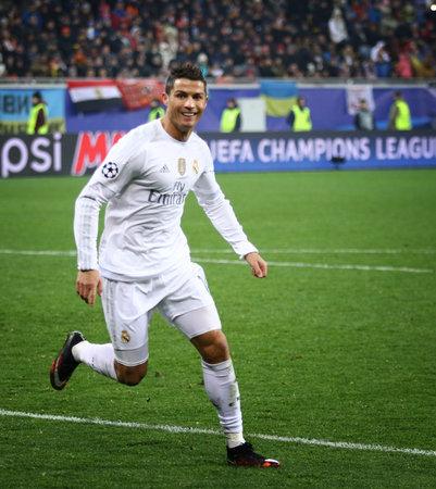 scored: LVIV, UKRAINE - NOVEMBER 25, 2015: Cristiano Ronaldo of Real Madrid reacts after scored a goal during UEFA Champions League game against FC Shakhtar Donetsk at Arena Lviv stadium