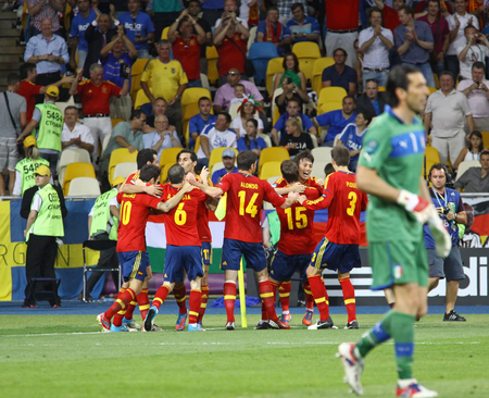 scored: KYIV, UKRAINE - JULY 1, 2012: Spain National team players celebrate after scored a goal during UEFA EURO 2012 Final game against Italy at Olympic stadium in Kyiv, Ukraine