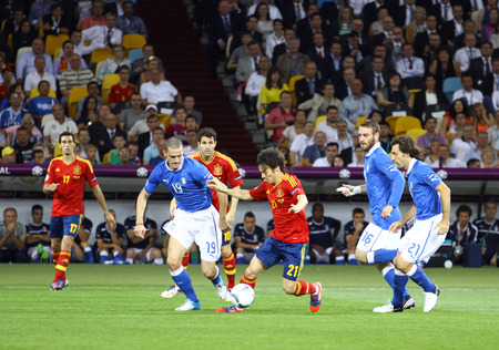 silva: KYIV, UKRAINE - JULY 1, 2012: David Silva of Spain (in Red, #21) attacks during UEFA EURO 2012 Final game against Italy at Olympic stadium in Kyiv, Ukraine Editorial