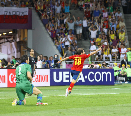 scored: KYIV, UKRAINE - JULY 1, 2012: Jordi Alba of Spain (in Red) reacts after scored a goal during UEFA EURO 2012 Final game against Italy at Olympic stadium in Kyiv, Ukraine