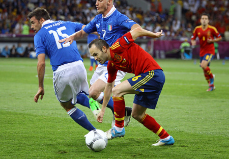 iniesta: KYIV, UKRAINE - JULY 1, 2012: Andres Iniesta of Spain (in Red) controls a ball during UEFA EURO 2012 Final game against Italy at Olympic stadium in Kyiv, Ukraine