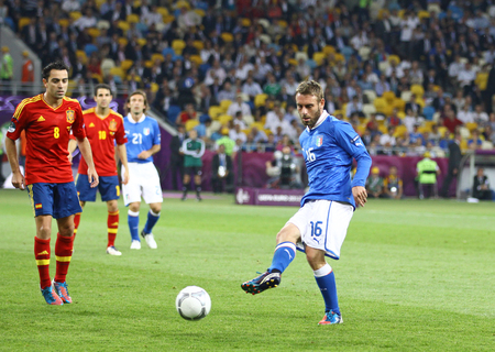 xavi: KYIV, UKRAINE - JULY 1, 2012: Daniele De Rossi of Italy (in Blue) kicks the ball during UEFA EURO 2012 Final game against Spain at Olympic stadium in Kyiv, Ukraine