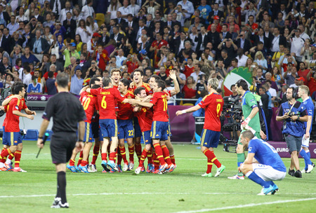 xavi: KYIV, UKRAINE - JULY 1, 2012: Spain national football team celebrates their winning of the UEFA EURO 2012 Championship after the final game against Italy at NSC Olympic stadium in Kyiv, Ukraine