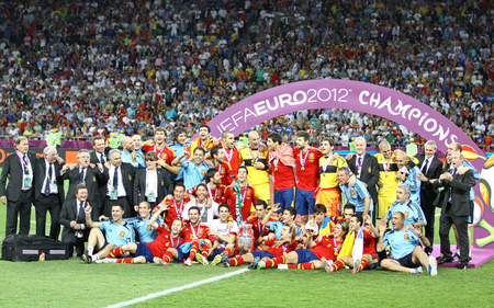 iniesta: KYIV, UKRAINE - JULY 1, 2012: Players of Spain national football team celebrates their winning of the UEFA EURO 2012 Championship after the final game against Italy at NSC Olympic stadium in Kyiv