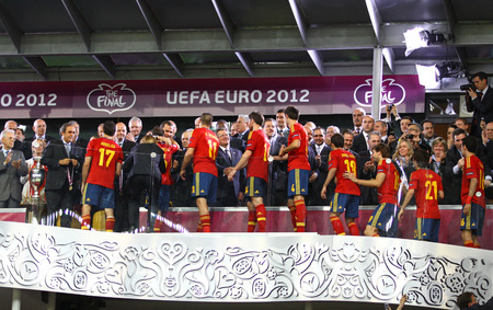 iniesta: KYIV, UKRAINE - JULY 1, 2012: Medal Ceremony fot Spain team after UEFA EURO 2012 Final game Spain v Italy at Olympic stadium in Kyiv. Spain won the game and the Gold Medals Editorial