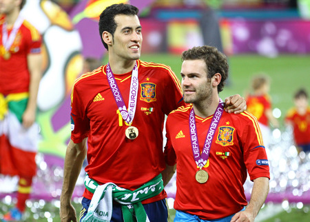 sergio: KYIV, UKRAINE - JULY 1, 2012: Sergio Busquets and Juan Mata of Spain walk on after UEFA EURO 2012 Final game against Italy at Olympic stadium in Kyiv. Spain won the game and the Tournament Editorial