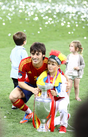silva: KYIV, UKRAINE - JULY 1, 2012: David Silva of Spain poses for a photo with his son after UEFA EURO 2012 Final game against Italy at Olympic stadium in Kyiv. Spain won the game and the Tournament Editorial