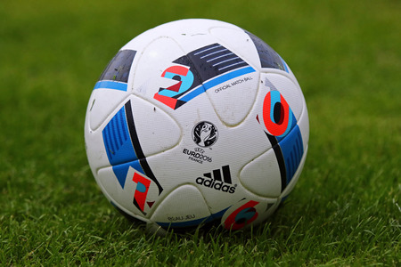 beau: KYIV, UKRAINE - MAY 20, 2016: Official match balls of the UEFA EURO 2016 Tournament (Adidas Beau Jeu) on the grass during the Open training session of Ukraine National Football Team in Kyiv, Ukraine