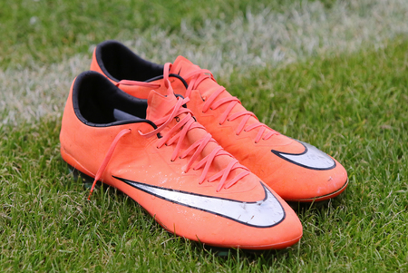 soccer shoes: KYIV, UKRAINE - MAY 20, 2016: Pair of soccer shoes on the grass field during the Open training session of Ukraine National Football Team before UEFA EURO 2016 Championship
