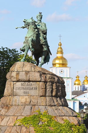 cossacks: Monument of Bohdan Khmelnytsky, the Hetman of Ukrainian Zaporozhian Cossacks, on Sofia square in Kyiv, Ukraine. St. Michaels Golden-Domed Monastery on the background Stock Photo