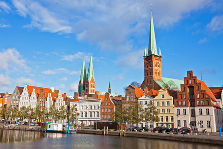 trave: Skyline of Lubeck old town reflected in Trave river, Germany