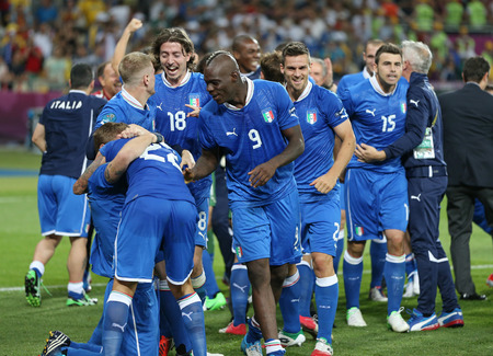 winning pitch: KYIV, UKRAINE - JUNE 24, 2012: Players of Italy national football team celebrate their winning after the UEFA EURO 2012 Quarter-final game against England at NSC Olympic stadium in Kyiv