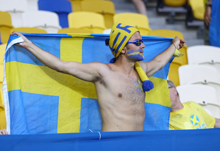 ultras: KYIV, UKRAINE - JUNE 19, 2012: Swedish football supporters show their support during UEFA EURO 2012 game against France at NSC Olympic stadium in Kyiv