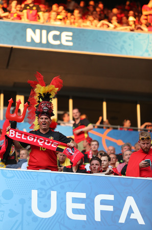 ultras: NICE, FRANCE - JUNE 22, 2016: Belgian fans show their support during the UEFA EURO 2016 game Sweden v Belgium at Allianz Riviera Stade de Nice, Nice, France. Belgium won 1-0