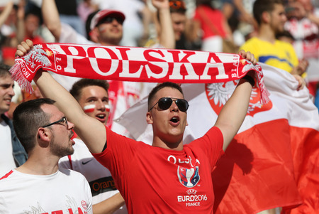 velodrome: MARSEILLE, FRANCE - JUNE 21, 2016: Polish fans show their support during the UEFA EURO 2016 game Ukraine v Poland at Stade Velodrome in Marseille. Poland won 1-0