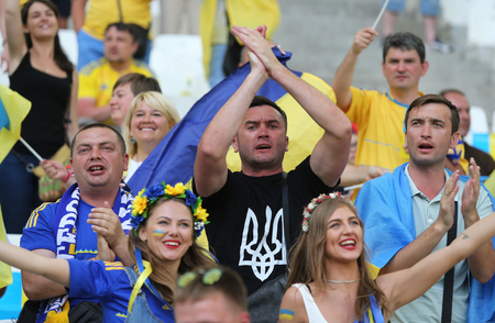 velodrome: MARSEILLE, FRANCE - JUNE 21, 2016: Ukrainian fans show their support during the UEFA EURO 2016 game Ukraine v Poland at Stade Velodrome in Marseille Editorial