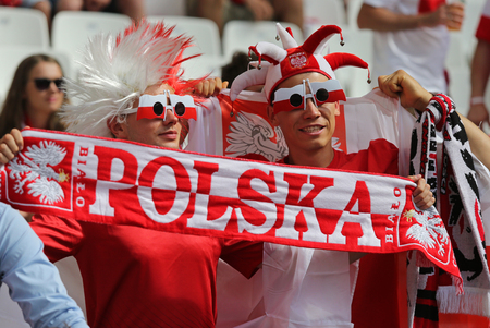 ultras: MARSEILLE, FRANCE - JUNE 21, 2016: Polish fans show their support during the UEFA EURO 2016 game Ukraine v Poland at Stade Velodrome in Marseille. Poland won 1-0