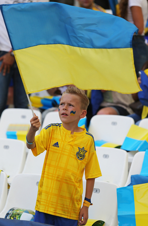 velodrome: MARSEILLE, FRANCE - JUNE 21, 2016: Young ukrainian fan shows his support during the UEFA EURO 2016 game Ukraine v Poland at Stade Velodrome in Marseille