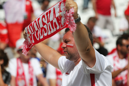 velodrome: MARSEILLE, FRANCE - JUNE 21, 2016: Polish fan shows his support during the UEFA EURO 2016 game Ukraine v Poland at Stade Velodrome in Marseille. Poland won 1-0 Editorial