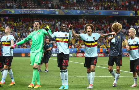 winning pitch: NICE, FRANCE - JUNE 22, 2016: Players of Belgium national football team thank their fans after the UEFA EURO 2016 game against Sweden at Allianz Riviera Stade de Nice, Nice, France. Belgium won 1-0