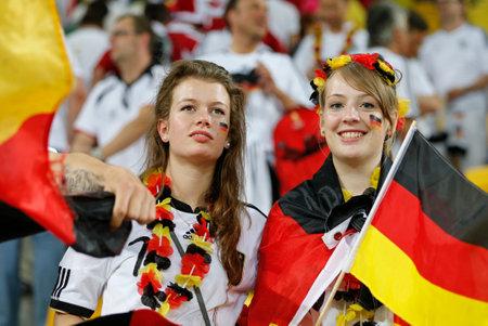ultras: LVIV, UKRAINE - JUNE 17, 2012: Germany football team supporters show their support during UEFA EURO 2012 game against Denmark at Lviv Arena in Lviv, Ukraine. Germany won 2-1