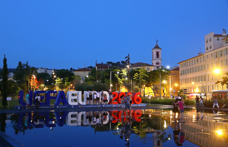 euro area: NICE, FRANCE - JUNE 24, 2016: People have fun in fountain near the big UEFA EURO 2016 letters at Promenade du Paillon in City of Nice, France Editorial