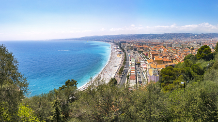 cote d'azure: Beautiful panoramic aerial view of beach in City of Nice in sunny summer day. Cote dAzure, France. City of Nice is a famous and luxury resort of French riviera Stock Photo