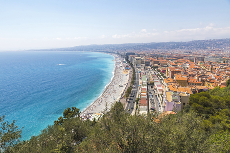 cote d'azure: Aerial panorama of beautiful beach in City of Nice in sunny summer day, Cote dAzure, France. City of Nice is a famous and luxury resort of French riviera Stock Photo