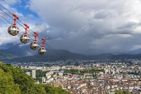 Picturesque aerial view of Grenoble city, France. Grenoble-Bastille cable car on the foreground (French: Telepherique de Grenoble Bastille)