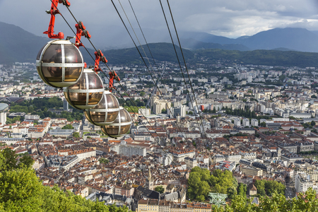 bastille: Picturesque aerial view of Grenoble city, France. Grenoble-Bastille cable car on the foreground (French: Telepherique de Grenoble Bastille)