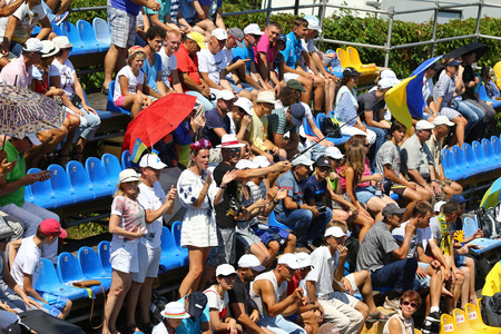 grand hard: KYIV, UKRAINE - JULY 15, 2016: Ukrainian supporters show their support during BNP Paribas Davis Cup EuropeAfrica Zone Group I game Ukraine v Austria at Campa Bucha Tennis Club in Kyiv, Ukraine Editorial
