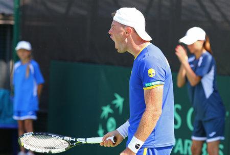 melzer: KYIV, UKRAINE - JULY 15, 2016: Illya MARCHENKO of Ukraine reacts after won the point during BNP Paribas FedCup match against Gerald MELZER of Austria at Campa Bucha Tennis Club in Kyiv, Ukraine