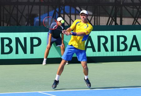 paribas: KYIV, UKRAINE - JULY 16, 2016: Artem SMIRNOV of Ukraine in action during BNP Paribas Davis Cup EuropeAfrica Zone Group I pair game against Austria at Campa Bucha Tennis Club in Kyiv, Ukraine Editorial