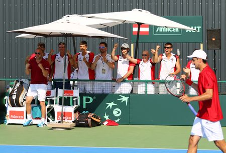 react: KYIV, UKRAINE - JULY 16, 2016: Players and Captain of Austria National Team react during the BNP Paribas Davis Cup EuropeAfrica Zone Group I pair game Ukraine v Austria at Campa Bucha Tennis Club