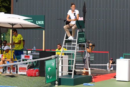 umpire: KYIV, UKRAINE - JULY 16, 2016: Chair umpire (tennis referee) on the position during BNP Paribas Davis Cup EuropeAfrica Zone Group I pair game Ukraine v Austria at Campa Bucha Tennis Club in Kyiv