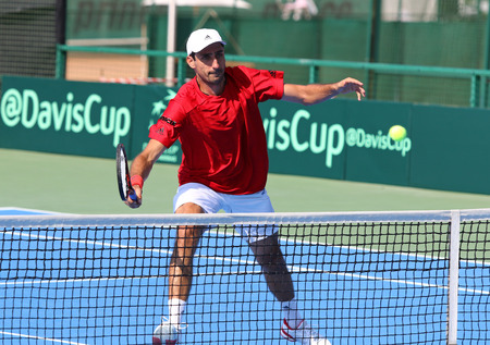 oswald: KYIV, UKRAINE - JULY 16, 2016: Philipp OSWALD of Austria in action during BNP Paribas Davis Cup EuropeAfrica Zone Group I pair game against Ukraine at Campa Bucha Tennis Club in Kyiv, Ukraine