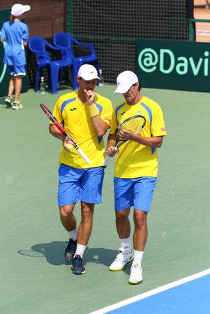 paribas: KYIV, UKRAINE - JULY 16, 2016: Denys MOLCHANOV (R) and Artem SMIRNOV of Ukraine react during BNP Paribas Davis Cup pair game against Austria at Campa Bucha Tennis Club in Kyiv, Ukraine