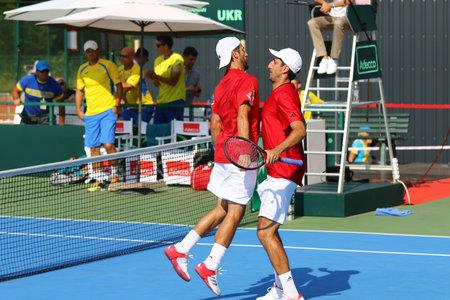 paribas: KYIV, UKRAINE - JULY 16, 2016: Jurgen MELZER (L) and Philipp OSWALD of Ukraine react during BNP Paribas Davis Cup pair game against Austria at Campa Bucha Tennis Club in Kyiv, Ukraine